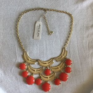 Red stone and gold metal necklace